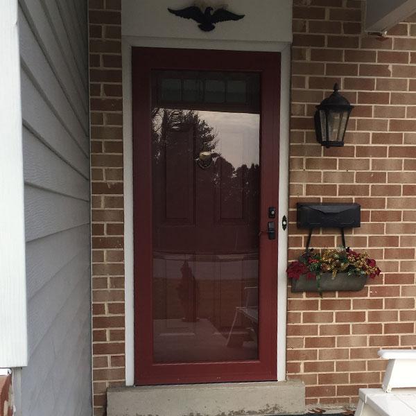 dark red glass storm door and  dark red entry door