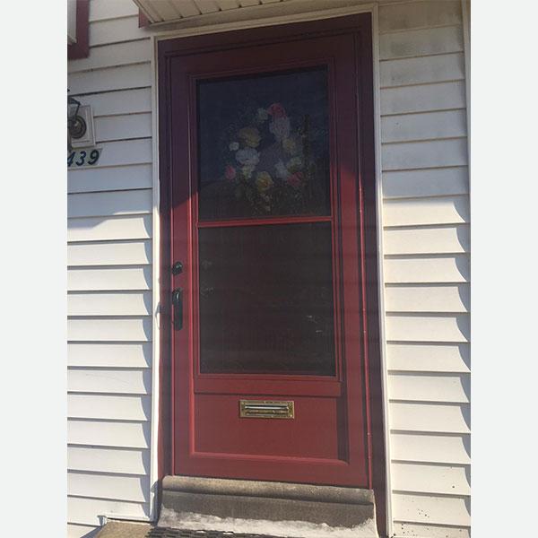 red front door with screen door in roxborough