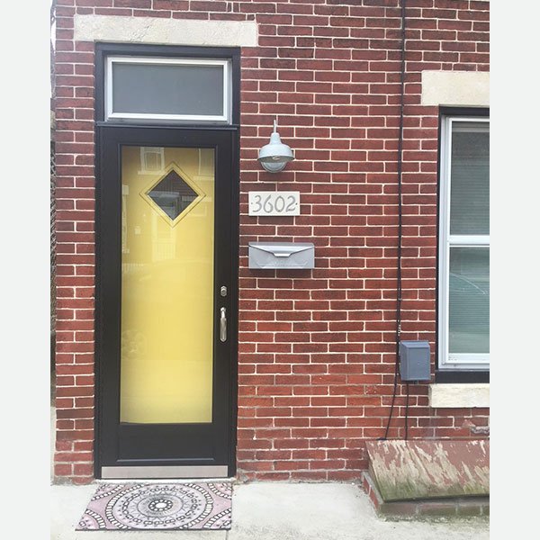 yellow front door with storm door in east falls