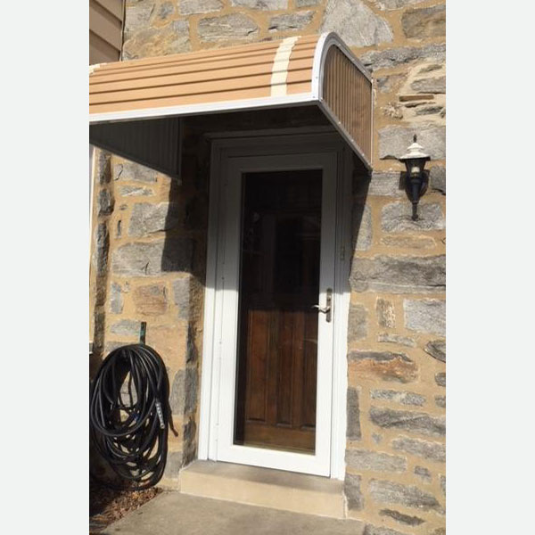 dark wood front door and white storm door in wynnewood