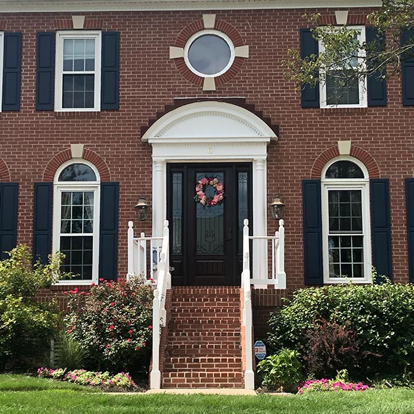 black entry door with sidelites and double hung windows in mt laurel