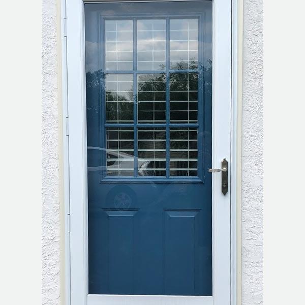blue front door with white storm door in blue bell