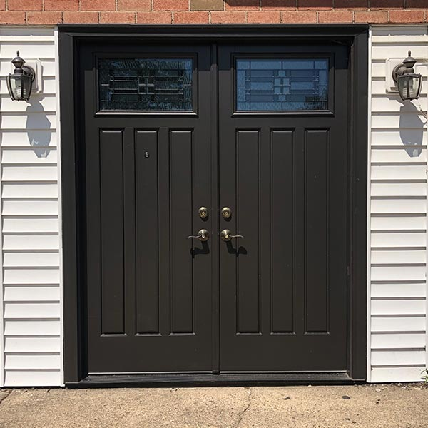 brown french doors with decorative glass in philadelphia