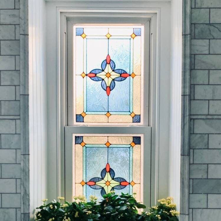 colorful stained glass in double hung window