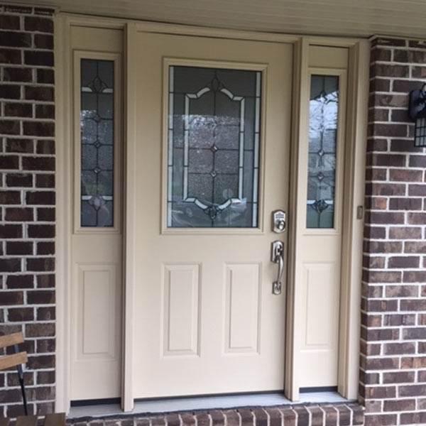 cream entry door with fancy glass and sidelites