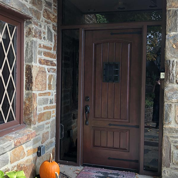 wood finish entry door with metal grating and sidelites in merion station pa